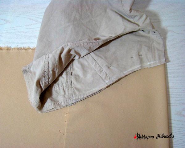 Приложить брюки на ткань